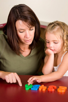 mother practicing numbers with child